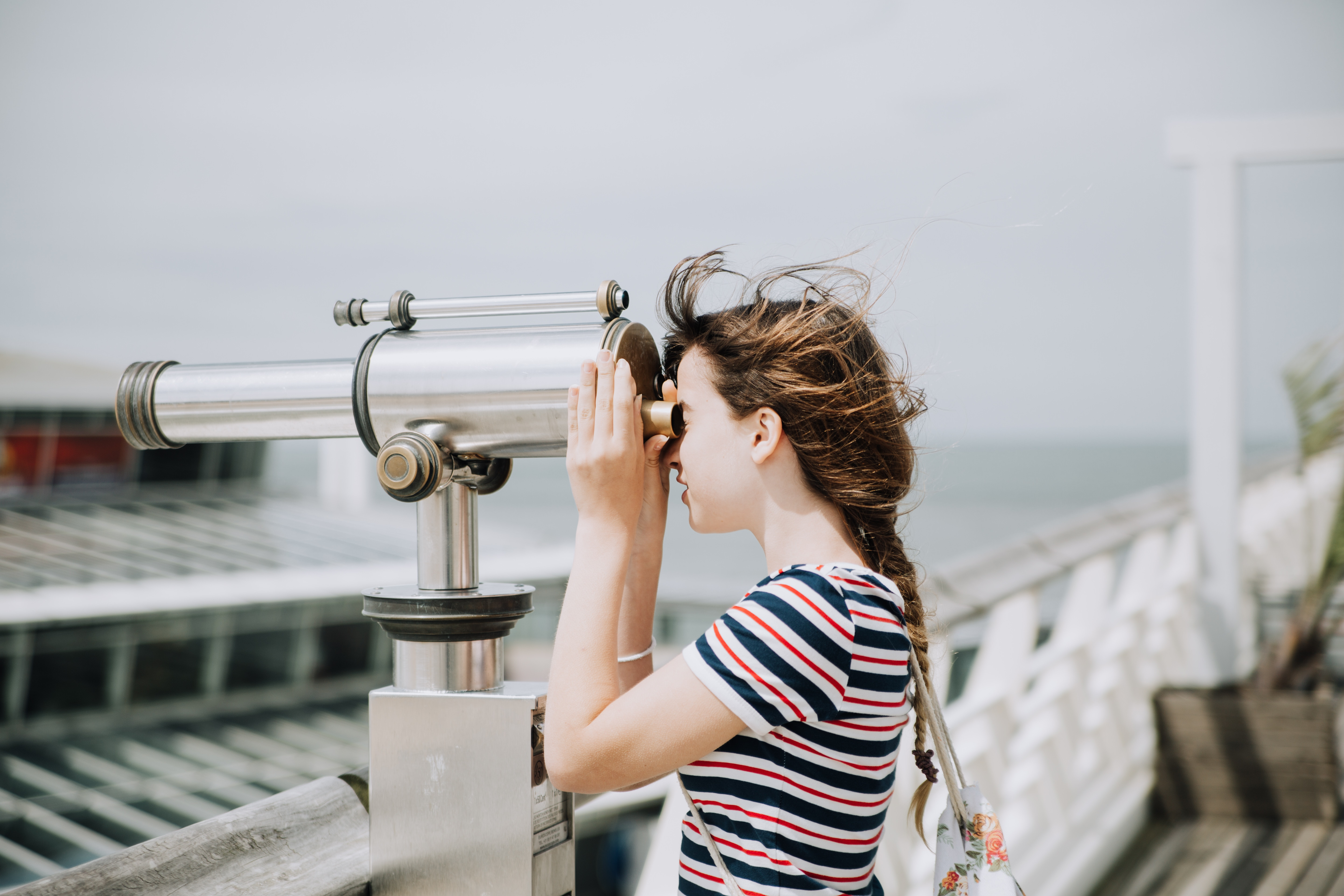 An employee with different abilities enjoys new perspectives by the seaside.