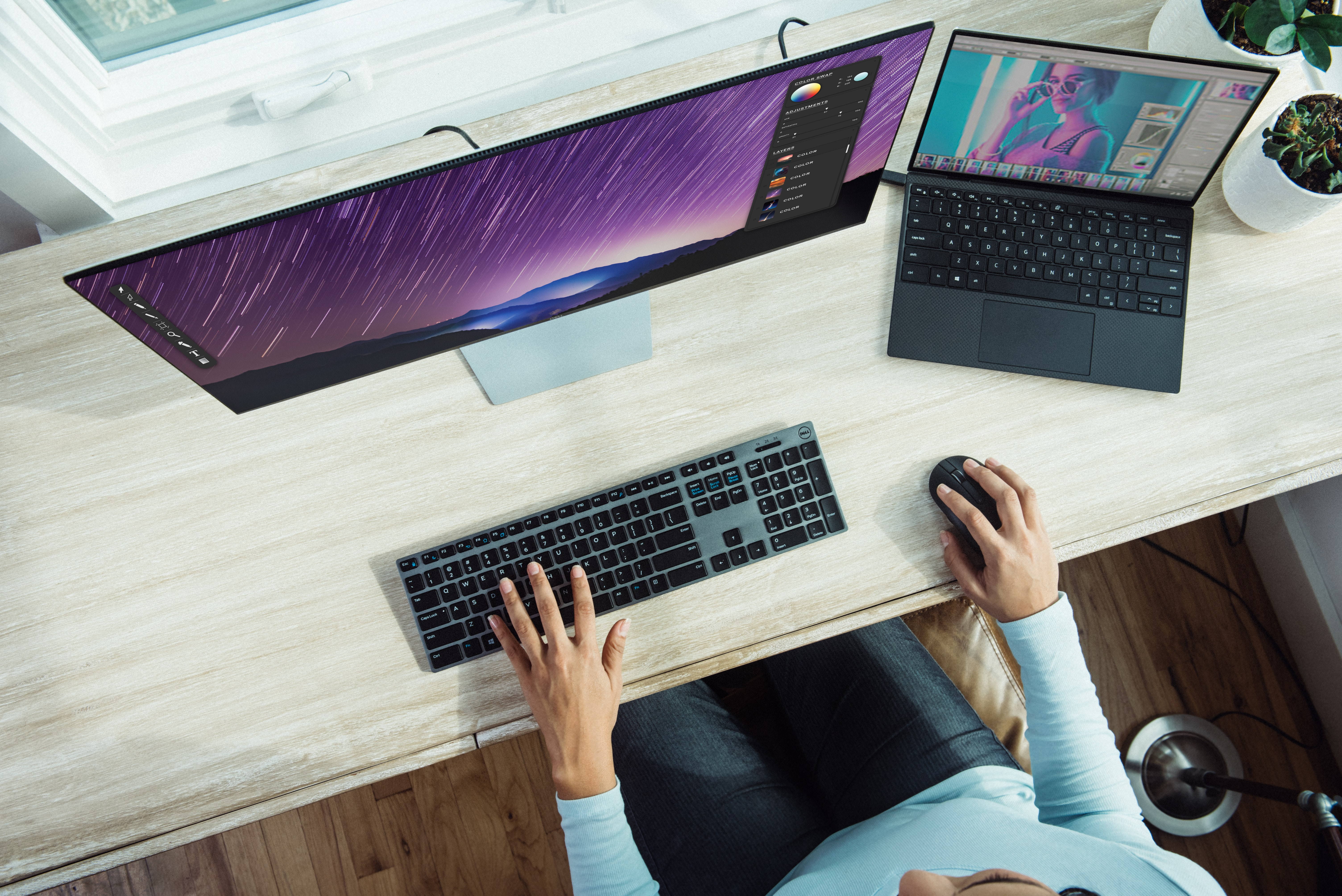 Employee adjusting to working from home with two monitors during COVID-19